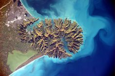A view of Banks Peninsula in New Zealand photographed from the International Space Station by ESA astronaut Alexander Gerst.