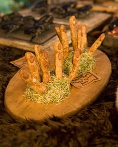 "Monster Fingers and Pimento Cheese Paws - Try serving these ""fingers"" and ""paws"" to your Halloween guests for a delightfully ghoulish surprise."