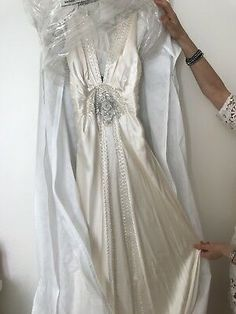 The dress falls beautifully to the floor with a slight train at the back. It has never been worn and it is still in the bridal dress cover.