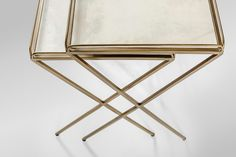 Betsy Nesting Tables: modern in design, our Betsy tables feature a delicate minimalist approach in unique materials – antique style brass finished metal and white vellum parchment.