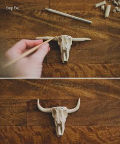 These are too flipping cute I can't even handle it. I want one just because to put on my desk. DIY Clay Steer Skull Escort Card