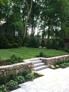 Carey Ezell Landscape Design Granite terrace and steps with field stone retaining wall and upper lawn surrounded by Frasier firs Arborvitae Dark American Rhododendron var. Backyard Retaining Walls, Stone Retaining Wall, Backyard Patio, Retaining Wall With Steps, Retaining Wall Design, Small Garden Retaining Wall, Backyard Ideas, Sunken Patio, Desert Backyard