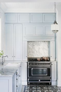 Pale blue cabinets.