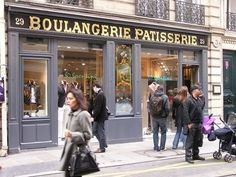 I want live in paris and go grocery shopping in these adorable little stores.. and then buy flowers at the flower stands.