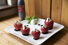 Goat cheese & Basil Whip Stuffed Strawberries w/ a Balsamic reduction glaze.... Sounds possible. And tasty!