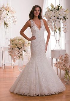 Our rich embroidered lace makes this wedding dress feel refined and extravagant. The classic v-neckline and fit and flare skirt are stylish and make this dress a perfect fit for any wedding.