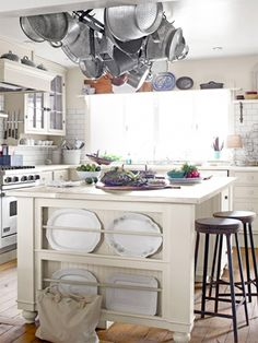 This kitchen island boasts a zinc top crafted by a local metal shop and has a built-in plate rack for stealthy storage.