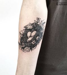 A nest tattoo by @Phil Tworavens in Calgary, Canada