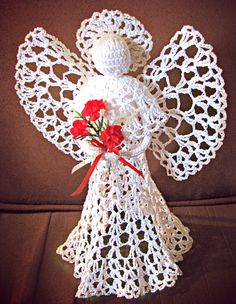 Beautiful Felicia is a large 'fan design' table/tree-top angel . She stands about 10 inches tall, and can have a multitude of different colored 'underskirts' to peek through her lace and also can have a metallic gold or silver edging on wings, halo and skirt.   Please specify color details in t...