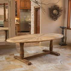 The Westland elm wood oval dining table is made of gorgeous old elm and has a beautiful natural finish. The table will give your decor a rustic feel.
