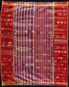Africa | Woman's wrapper from the Nupe people of West Africa | ca. 1950-80 | cotton plain weave with rayon supplementary weft | This type of wrapper, with elaborate weft inlays, would have been worn during weddings, market day and other special occasions. This type of garment is made of two woven panels that are sewn together to produce a wider cloth.