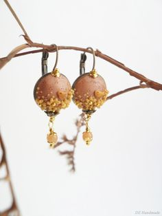 Soft pink and gold earrings in bronze frame. par DZHandmadeProducts, $26.90