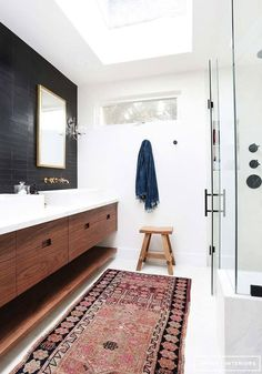 black and white bathroom with a moroccan rug