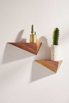Find some greenery to liven up your space with the Plant Shop at Urban Outfitters. Shop succulents, planters, and wall shelves for plant storage and decor. Triangle 3d, 3d Pyramid, Cool Shelves, Wall Shelves Design, Wall Storage, Small Apartments, Floating Shelves, Hanging Shelves, Diy Furniture