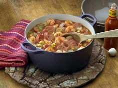 Simple Shrimp Creole Recipe Main Dishes with Johnsonville Andouille, Pompeian Canola Oil and Extra Virgin Olive Oil, onions, green pepper, celery, Gourmet Garden garlic paste, chicken broth, Tuttorosso Diced Tomatoes, frozen whole kernel corn, brown sugar, cayenne pepper, large shrimp, salt