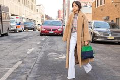 Man Repeller at NYFW AW 2015/16 Coat from Isa Arfen, sweater from Rosie Assoulin, J Brand jeans and Miu Miu bag.