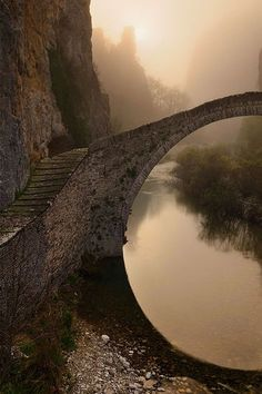 The single arched stone bridge of Kokkorou named after its sponsor dating back to the 1750's. Epirus, Greece. by Yolanda Salgado