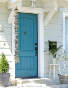 Driftwood garland for the Front Door: http://www.completely-coastal.com/2013/09/driftwood-garland.html A lovely blue front door is enhanced with a coastal garland!