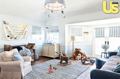 Shabby Chic designer Rachel Ashwell was handpicked to decorate Ace Simpson's custom blue nursery, which features a denim patchwork chair, an embroidered wall-hanging, and striped window shades.