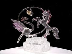 Phoenix and unicorn wedding cake top all genuine hand blown glass.