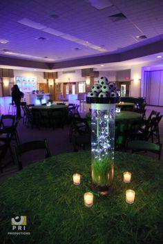 Sports themed centerpieces with votive candles Purple LED lights set up around the venue. Bat Mitzvah Decorations, Bar Mitzvah Centerpieces, Banquet Centerpieces, Lighted Centerpieces, Birthday Party Decorations, Soccer Decor, Soccer Theme, Sport Theme, Sports Themed Centerpieces