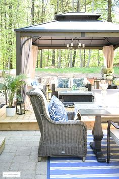 Create the ultimate outdoor living space by bringing the indoors out - from beautiful baskets and cozy blankets to elegant garden stools and decorative pillows - you can have the backyard of your dreams with these simple to follow tips! #outdoor #outdoordecorating #backyard #patio #patioideas