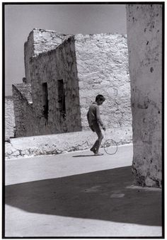 Boy with a hoop, Crete, Greece, 1964 - Greek America Foundation; Photograph by Constantine Manos, Magnum Photographer