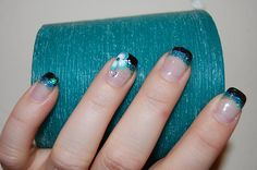 Black, blue, green glitter and flower nails