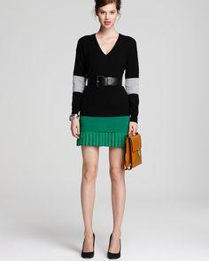 Longer skirt. Plain black sweater.