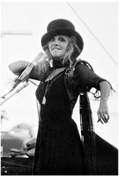 Stevie onstage outdoors, in the late 70's with all her trademark clothes, and biting her lower lip, an endearing habit she has ☆♥❤♥☆