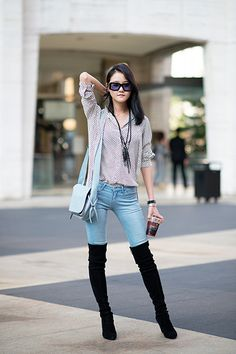 Tuck in your ultra-skinny jeans into a pair of tight thigh-highs. A loose, unbuttoned blouse and fringed necklace keep your boho vibe going strong.