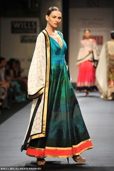 A model displays a creation by designer Manish Malhotra on Day 2 of Wills Lifestyle India Fashion Week in New Delhi on October 07, 2012.