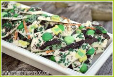 Leprechaun Crunch  White Chocolate for melting  Mint filled Oreos, broken up  Mint M or green M  Andes Mints, broken up  Pretzels, broken up  Sprinkles in the color of your choice  Leprechaun Hat Marshmallows from Lucky Charms Cereal