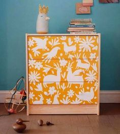 Would love to do something like this for Gabe's dresser. Must find space/robot themed stencils