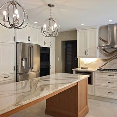 Social media is amazing! Thanks to she was able to send us finished photos of the Brittanicca Gold kitchen! Cambria Countertops, Calacatta Gold Marble, White Kitchen Backsplash, Galley Kitchen Remodel, Long Kitchen, Kitchen Design, Kitchen Ideas, New Homes, Hashtags