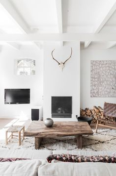 Scandinavian living room with large white #Moroccan carpet // we sell creamy vintage Moroccan carpets at www.maroctribal.com
