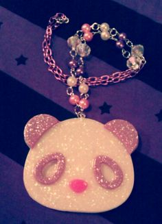 You are viewing a listing for a one of a kind panda resin necklace! Panda pendant completely hand casted with resin, adorned with tons of glitter. I hand beaded each and every bead, mixture of glass and acrylic beads. Pendant measures 3x2, and chain measures 24'' long. I can do any colors, so sen...