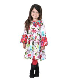 Bell sleeves and a big-time bow add cheer to this colorful festive dress. Coordinating leggings complete the ensemble, while cotton offers a soft feel. Includes dress and leggings Dress: knit Dress: 100% cotton Leggings: 95% cotton / 5% spandex Machine wash; tumble dry Imported