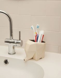 Finally, a toothbrush holder that's just as adorable as it is functional. Brushes store standing up so they can dry thoroughly, and excess water drains out of the elephant's trunk. $25, 1designerperday.com  - GoodHousekeeping.com