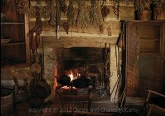 Drying herbs over rustic fireplace~  Luv it!