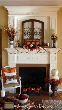 love the urn filled w/ pumpkins, the pillow tied up w/ muslin, & the framed ironwork on the fireplace!