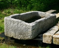 Large antique carved Cornish stone trough from Somerset England. (Please see picture for close up view of the stone.) This trough has an old repair to the back panel. Although the trough is capable of holding water, we would not recommend fountain use. Good patina. Circa 1800 Imported from England. To read about the history of antique troughs, please visit our blog . Somerset England, New England, Garden Ornaments For Sale, Cement Garden, Stone Basin, Trough Sink, Mortar And Pestle, See Picture, Carving