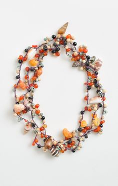 Crocheted silk necklace with shells, bamboo, wood, horn, agate, coral, onyx and turquoise beads