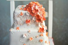 White cake with coral flowers...absolutely stunning!