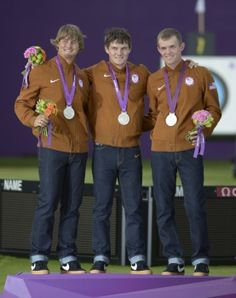 (L to R) Brady Ellison of Glendale, Jake Kaminski and Jacob Wukie pose after winning the Silver Medal in Men's Team Archery for the United States! (Photo: Kirby Lee/US Presswire)