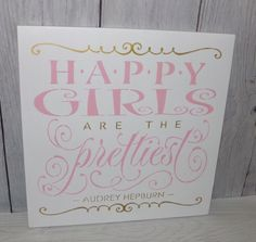 This is a solid wood sign that measures 12 X 12 X 3/4.    The sign reads:  Happy Girls Are The Prettiest  Audrey Hepburn  The sign shown has