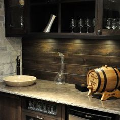 Wood backsplash for wet bar creates a great rustic feel.