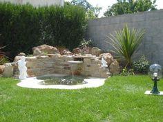 Bassin et fontaine int gr e jardin pinterest for Bassin aquatique exterieur