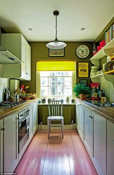 Decorator and architect BEN PENTREATH and husband CHARLIE have turned up the volume on pattern and colour in their eye-poppingly eclectic London home Cottage Kitchen Renovation, Cottage Kitchens, Kitchen Remodel, Kitchen Tiles, Kitchen Colors, Kitchen Dining, Kitchen Decor, Ben Pentreath, Orange Kitchen