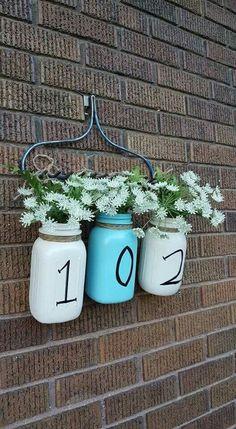 A Hanging Floral Arrangement with Milk Jugs